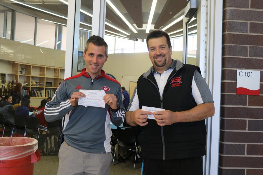 Mr. Beck and Dr. Dun collect lunch tickets at Panda Express Celebration.