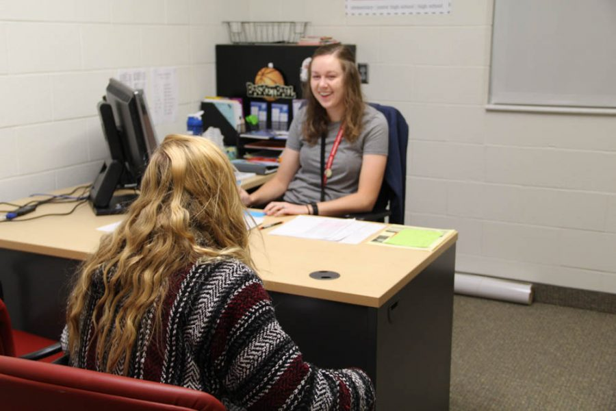Ms. Catten helping make Skye Rouse's day better with a little bit of laughter.