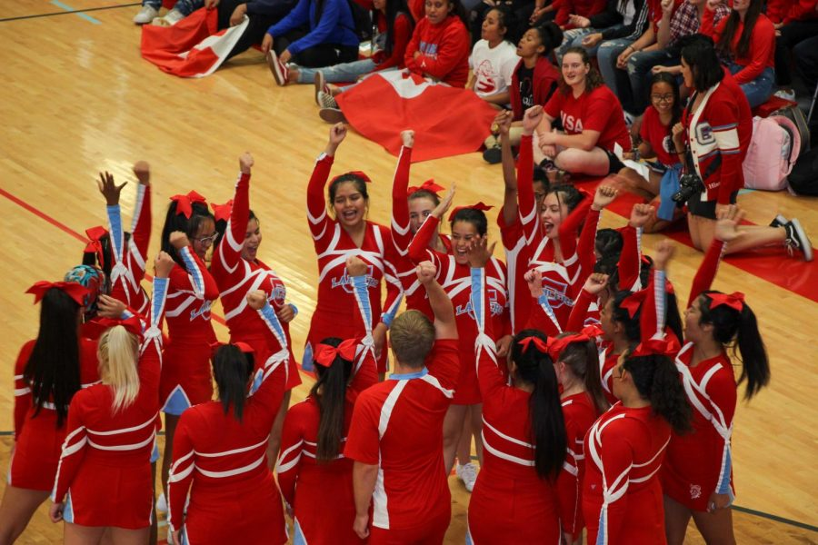 Granger+High%27s+cheerleaders+prepare+for+their+aerial+stunts+at+the+homecoming+spirit+assembly.+
