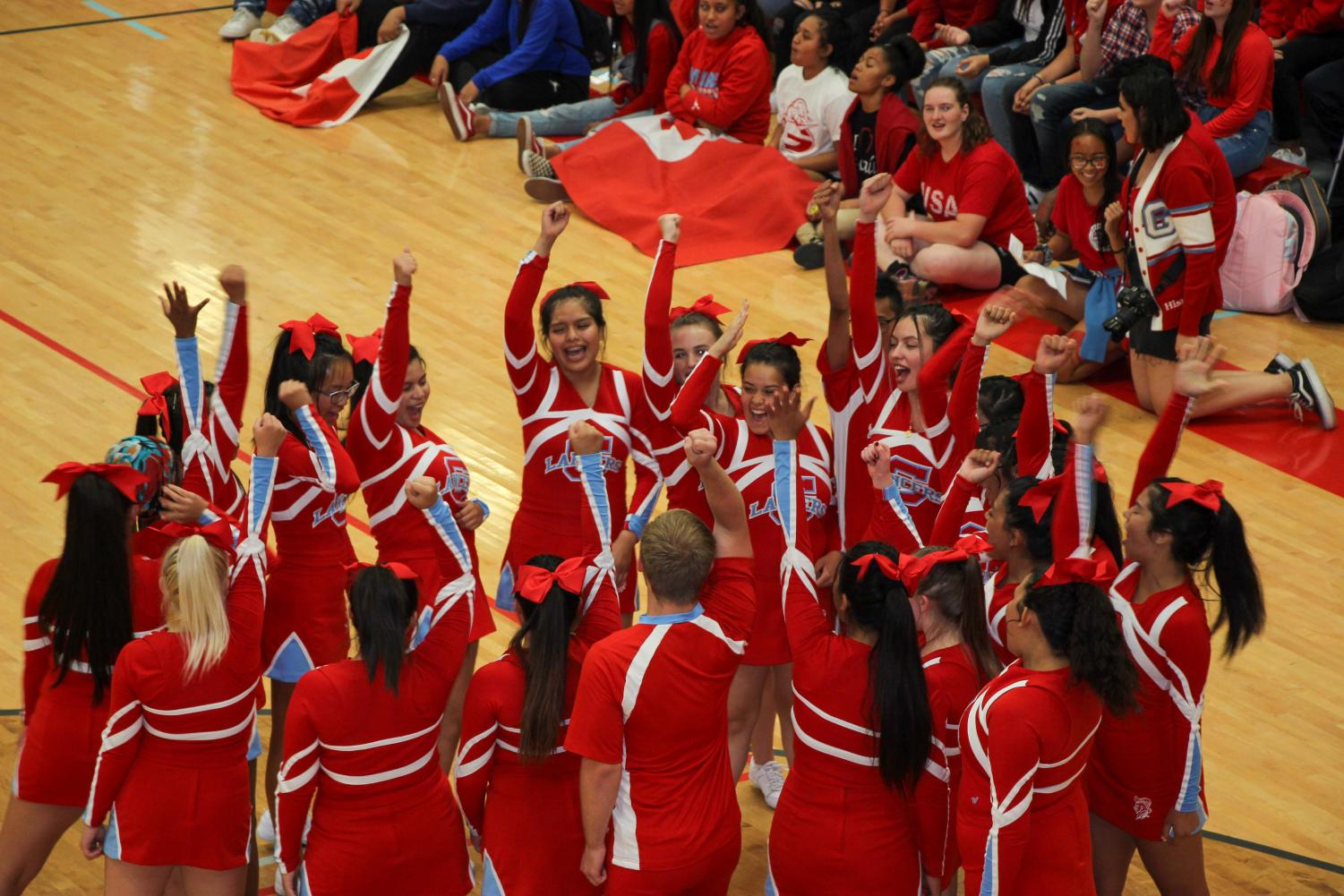 Granger High's cheerleaders prepare for their aerial stunts at the homecoming spirit assembly.